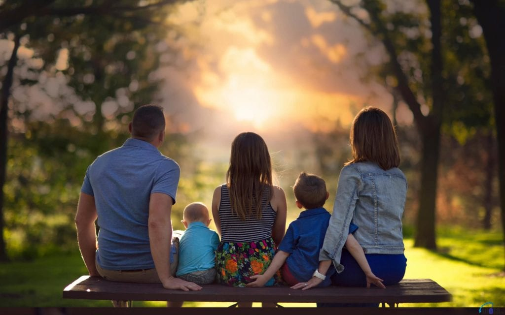 healthy family watching sunset